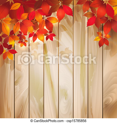 Autumn background with leaves on a wood texture - csp15785856