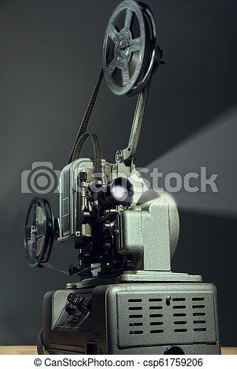 Cinema projector with a film on dark background - csp61759206