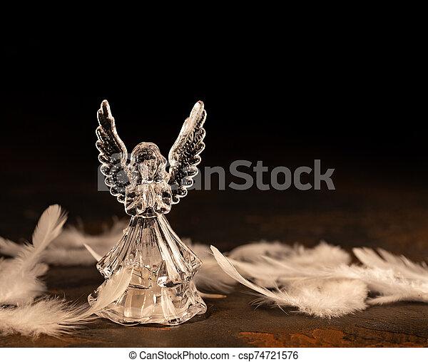 Glass angel on a dark background - csp74721576