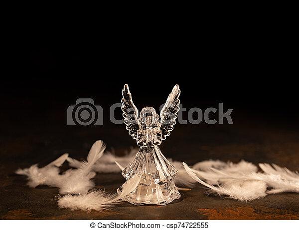 Glass angel on a dark background - csp74722555