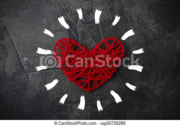 Heart with rays of sun on a dark background. Valentine's Day - csp55725289